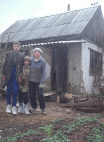Me and my sister with Grandma Tamara at her dacha