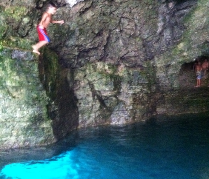 Cliff diving inside the Grotto