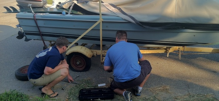 Doug and Jeff changing the flat tire