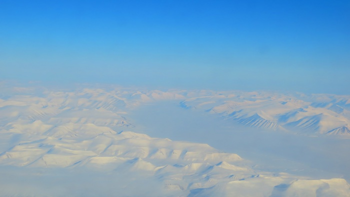 Flying over Svalbard is different. Very different.