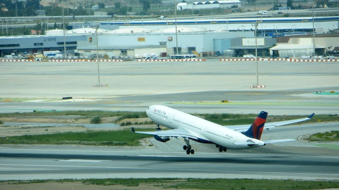 Delta A330 taking off with an empty section of T2 in the background