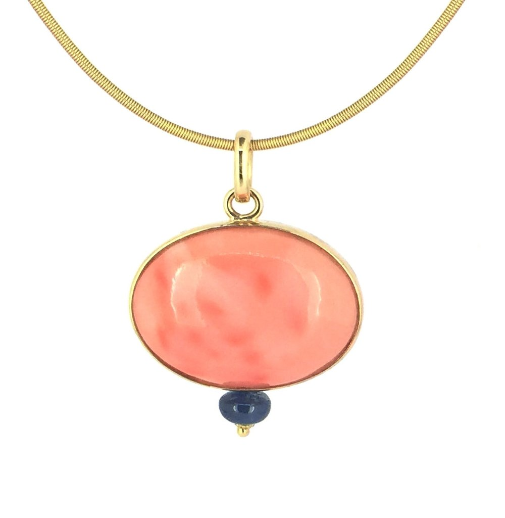PEndant of vintage Angel Skin Coral with sapphire in 18K
