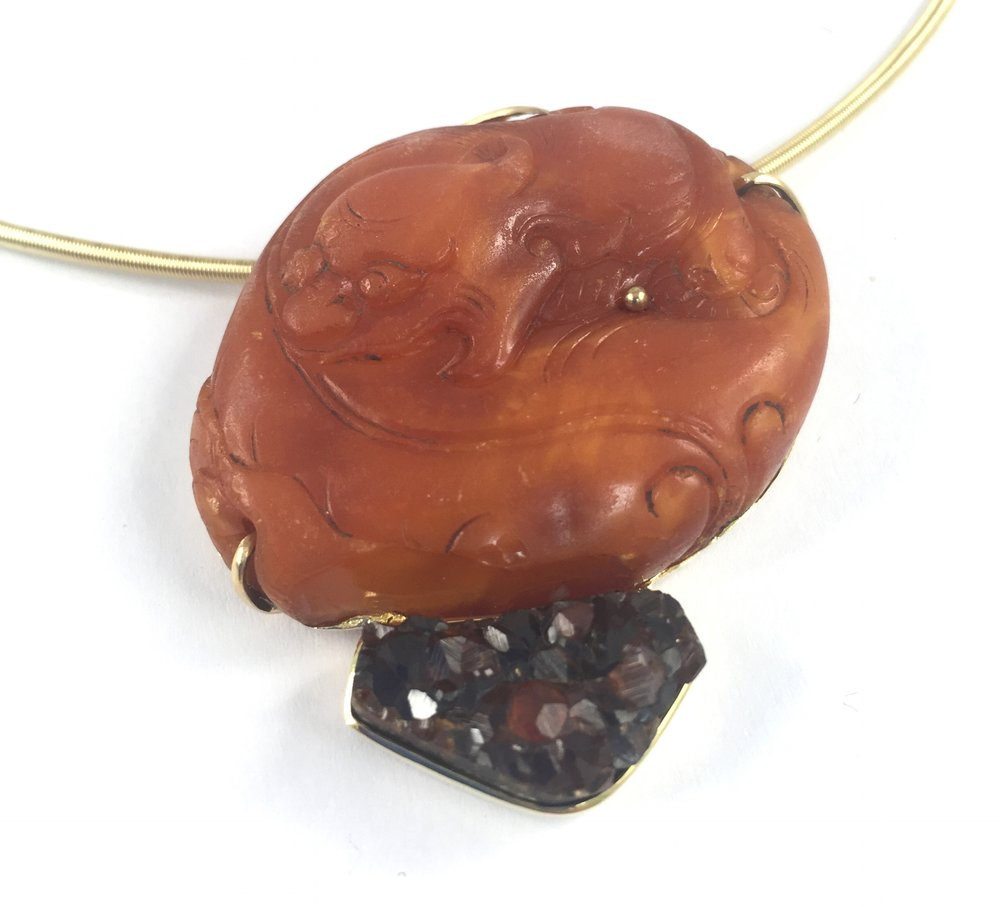 Pendant of MIng dynasty antique carved Tiger in amber with drusy garnet in 18K.