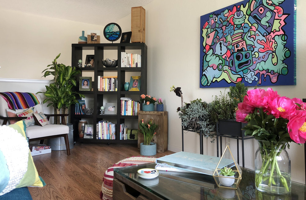 View from my favorite corner of the couch. Beautiful peonies and plants sprinkled in amidst the colorful art.