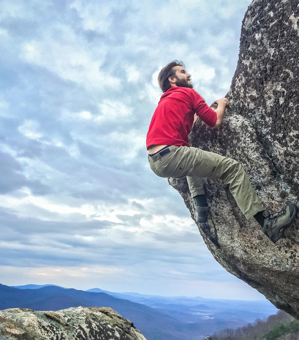 Mon climbing up the Balance Rock