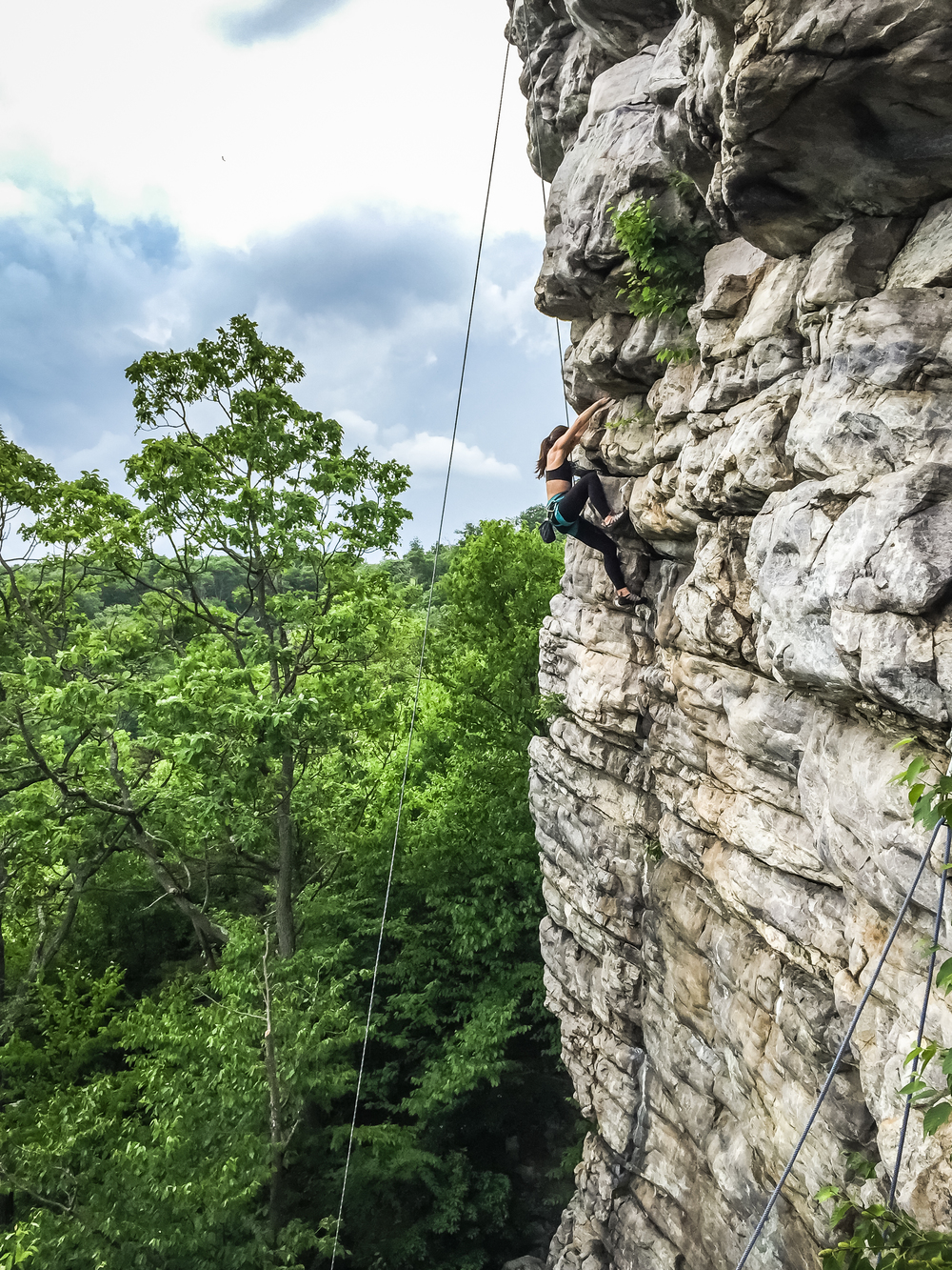 Climbing Annapolis Rock:Raisa climbing Black Crack (5.9+)