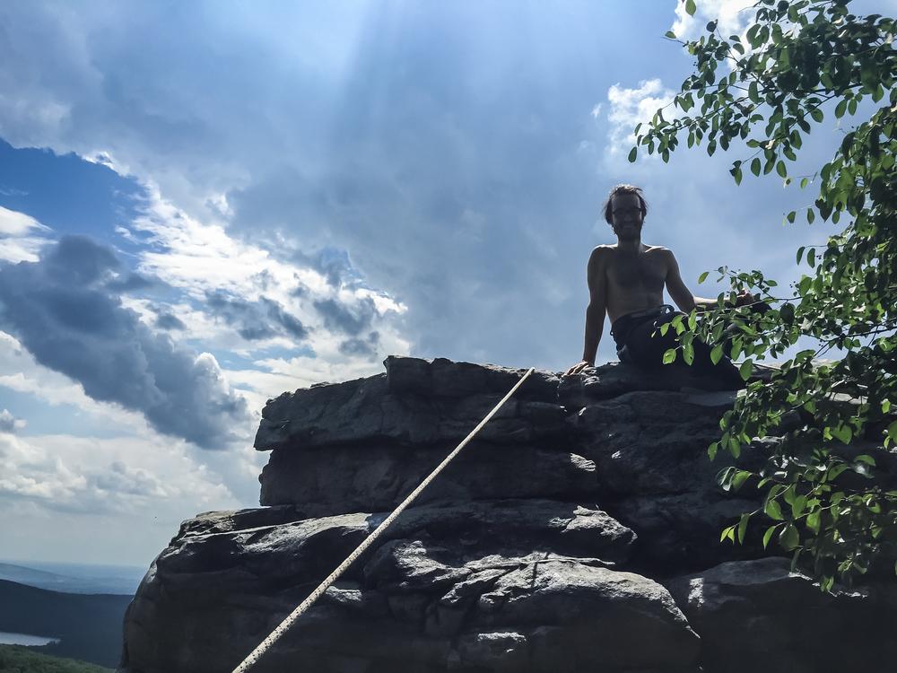 Mon enjoying the overlook after climbing
