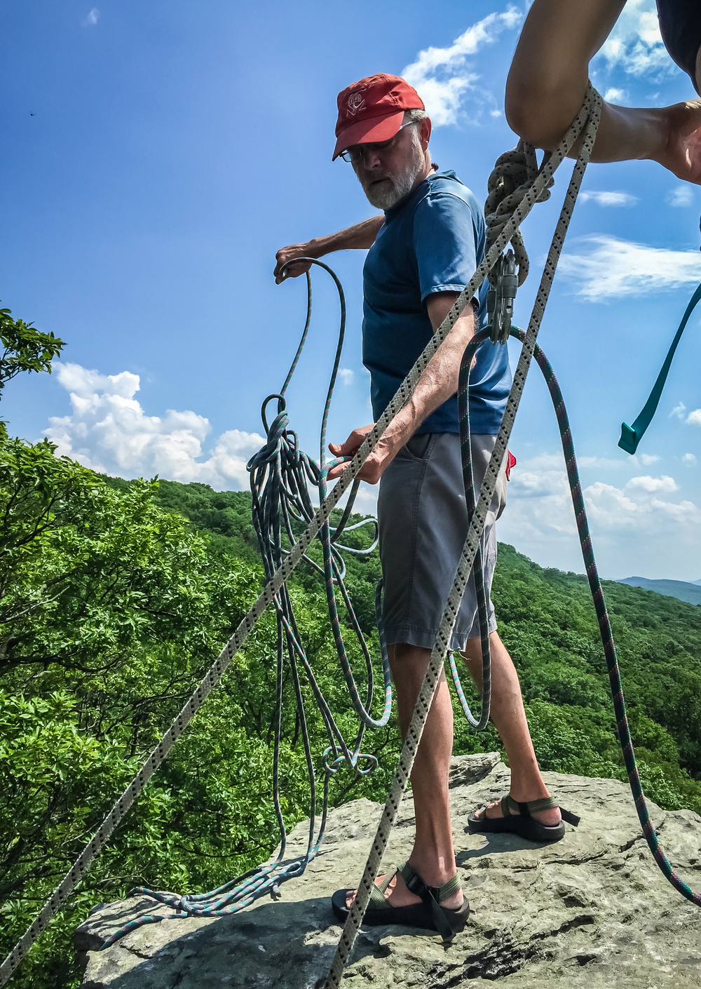 Dan setting the anchor of Black Crack (5.9+) - Climbing in Annapolis Rock