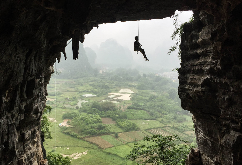 Miguel climbing in Treasure's Cave, Yangshuo