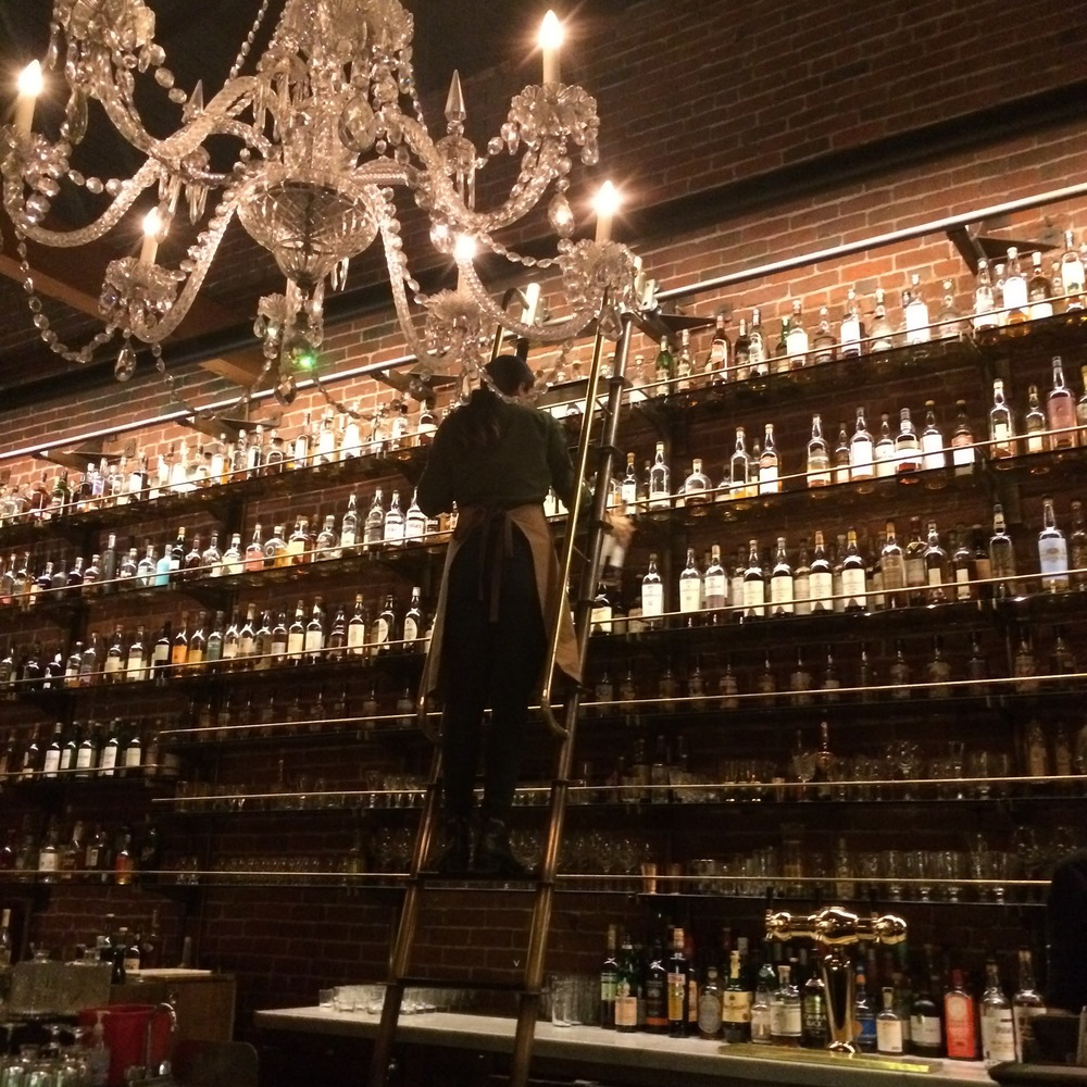 "This spot can have up to a two hour wait! Even if you're not a big whiskey drinker (I'm certainly not!), the ambiance is unreal. The host/hostess will lead you upstairs to the ""library"" where hundreds of whiskey bottles line the walls."