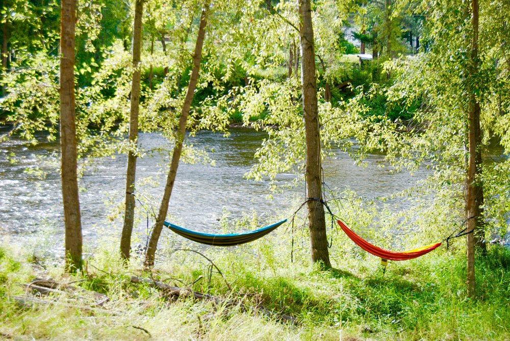 These hammocks belong to me and my friend Maya. We set up camp there all weekend and enjoyed the passing of the hours, the gentle sound of the river, great music coming from neighbors, twinkling stars, and a few naps. This year the weather was so nice that I spent one night in my hammock. Sleeping bags are definitely recommended. Cuddles optional.  I mentioned this place is a place for community. That means at no point did I feel the need to worry about leaving my hammock there or the risk of having it stolen. I did get a lot of compliments in my placement. Not going to lie, I put it on a very sketchy ledge. But hey, when you find the perfect view, you make it happen.  The fairground is right by Kettle River. It's a shallow lazy river. You can just set up your chair in a sunny spot, or bring your floaties and float on down the river. There are shuttle that pick you up and bring you back up to the festival so you barely have to do anything! Given that the stage is right on the other side of the river, you can either use the sound of music as your clock, or you can just choose to enjoy the music from your chair, or floatie. Just don't litter- that's not cool. Bring an ashtray and collect your beer cans.