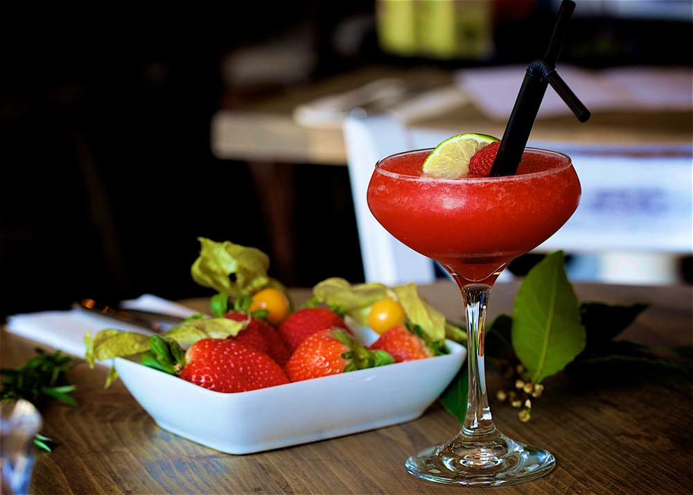 Pull up a stool at our relaxing bar   Try our refreshing Strawberry Rose Sangria   Book Now