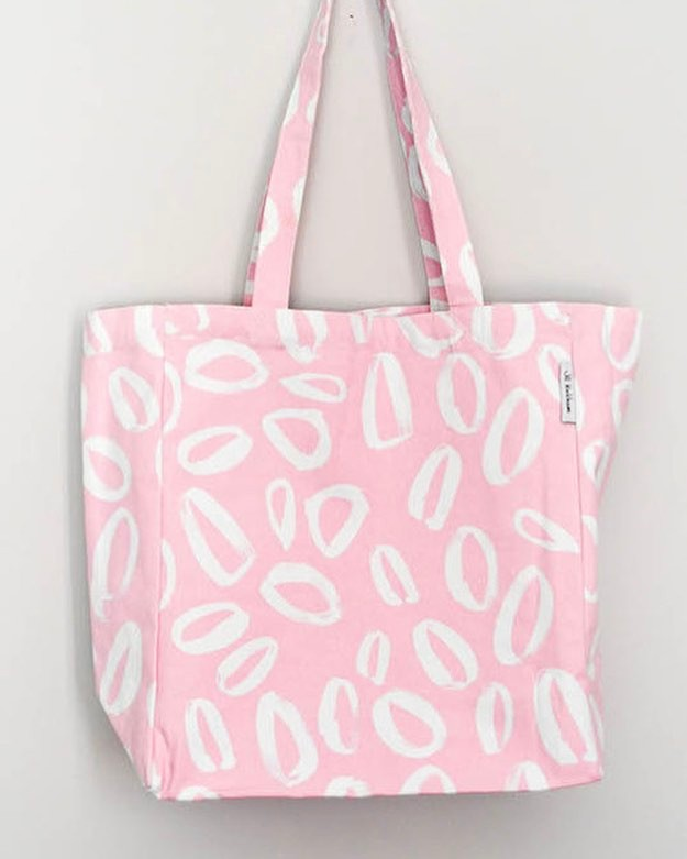 Pink Over Size Tote Bag.  Spring Sale £10  The design for this bag was inspired by leopard print but has been printed in a rose pink for fresher brighter feel.  This is a fantastic bag ideal for shopping, the beach or books.  Screen printed on 100% natural canvas.  It measures 40cm tall, 35cm wide and 15cm deep.  All products are individually screen printed and produced in my Glasgow Design Studio.  The production time will be a maximum of one week before shipping.  #totebag #sale #springsale #glasgow #scotland #shoplocal #handmade #madeinglasgow #urbanmarket #jillkirkham #bags #pink