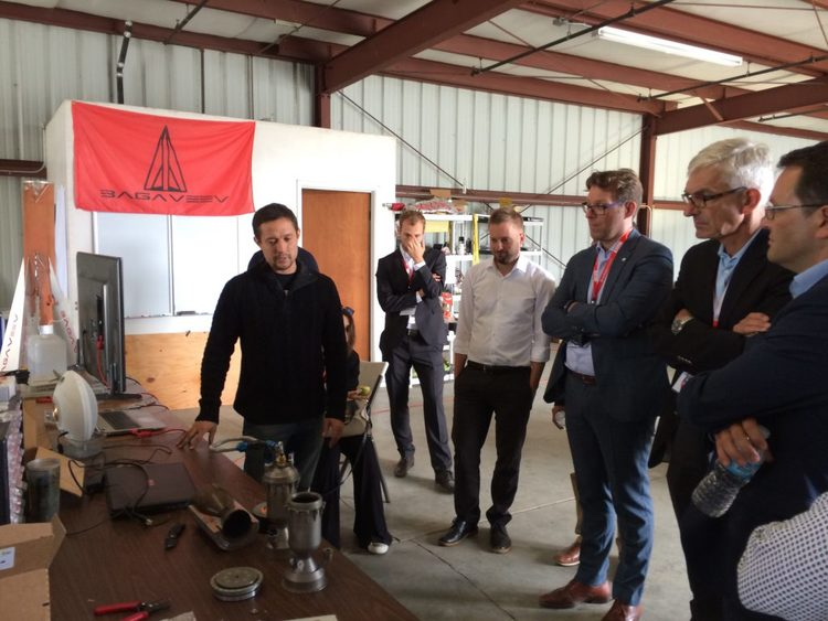 Delegation inspecting rocket parts at Bagaveev Corporation