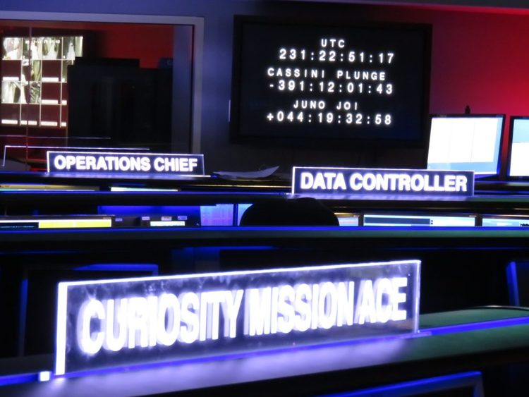 Some signs within the control room for the various stations that control the spacecraft