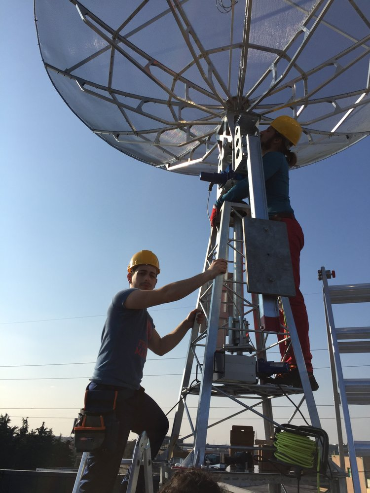 Working on the antenna at the ground station in Milan. Image credit: Leaf Space