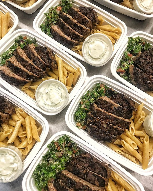Out for delivery today: Greek Burgers!! 🇬🇷 Inspired by Bel's trip to Greece, our grass-fed sirloin patties are full of herbs and grilled to perfection. Served with tabbouleh, house tatziki, and penne with olive oil 👌 Next week's menu is live and the link is in our bio! Order by Wednesday at 9pm! 📸: chef Ellie! @eliska413