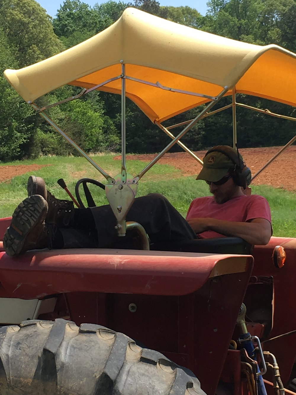 George taking a rest on the tractor, July, 2018