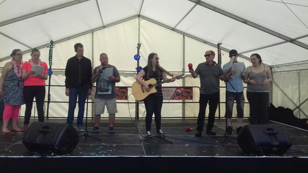 Pat, Iain and friends join Teela on the community stage to sing a few numbers!