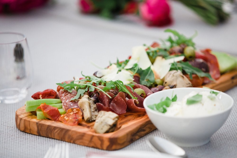 SHARING BOARDS - A less formal approach to dining, our feast style boards are a great crowd pleaser. Served to tables to encourage guests to share amongst themselves.