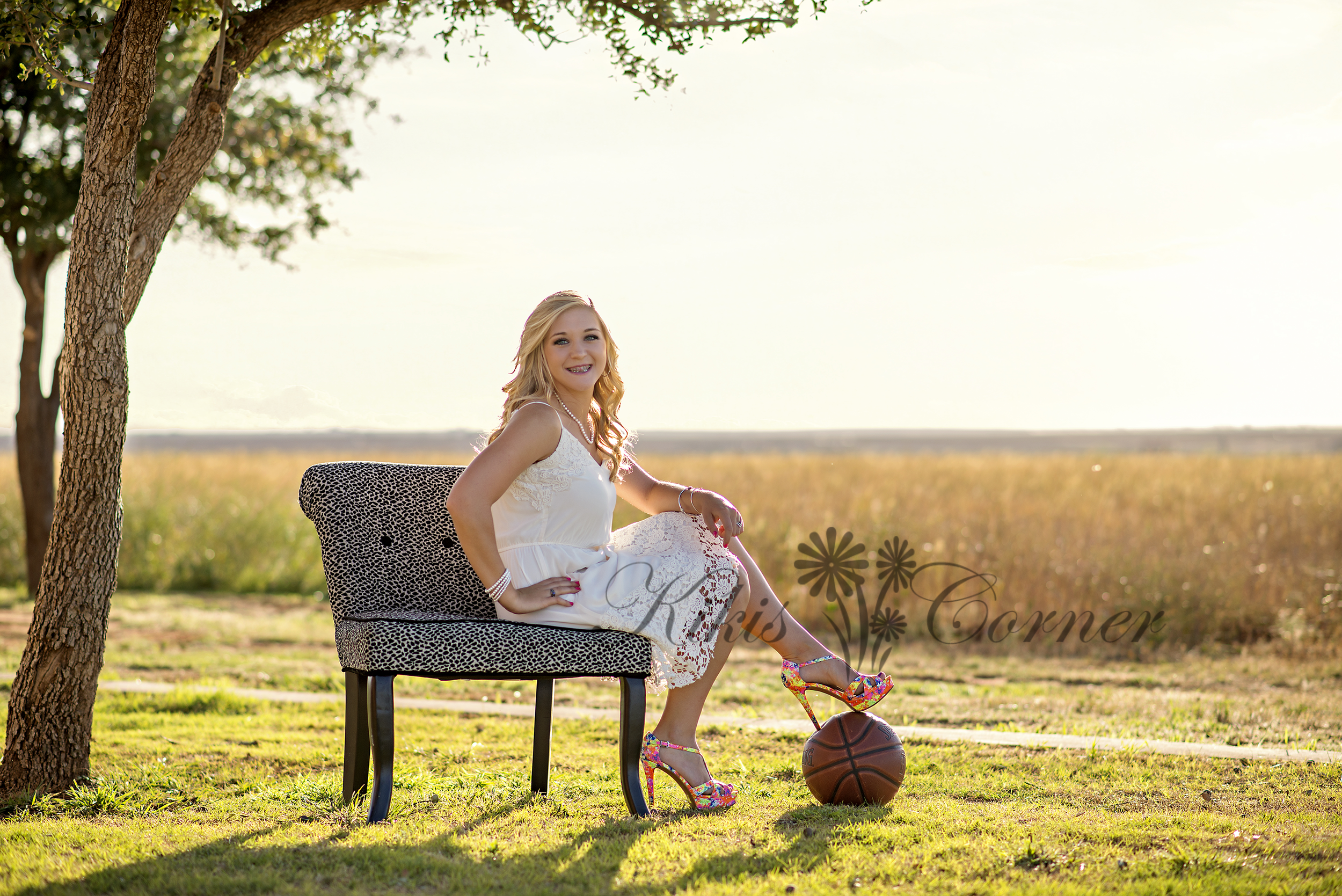 senior with basketball in field