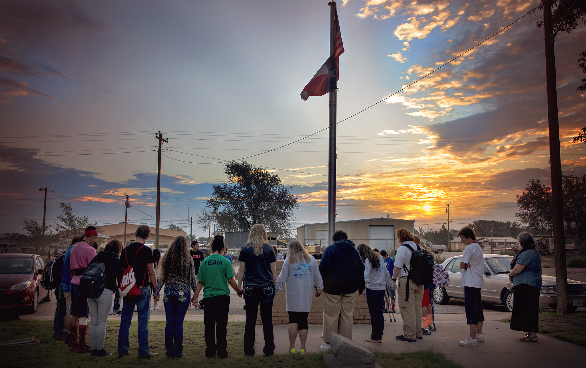 See you at the Pole, sunrise, flag, students praying