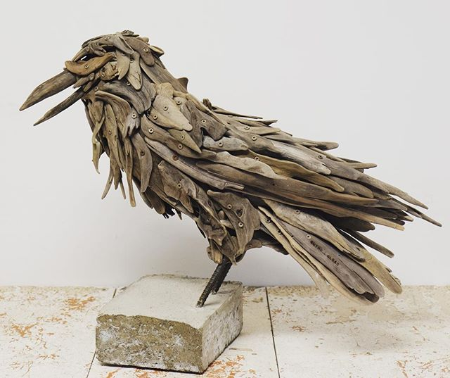 """""""Trouble"""" a common raven. Soon to be on display at Madrona gallery. @madronagallery #raven #driftwood #westcoast #pnwartist #NWC #pnwbc"""