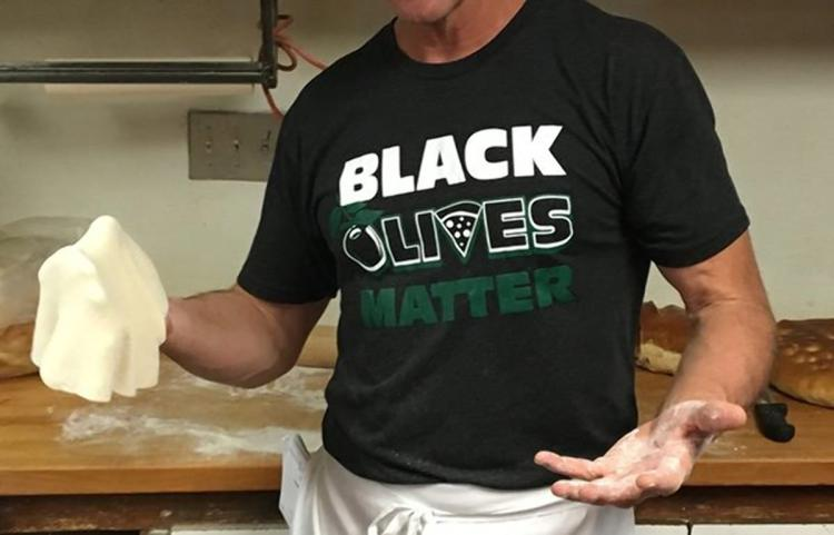 Paisano's doubled down with it's Black Olives Matter slogan by selling the design as t-shirts.
