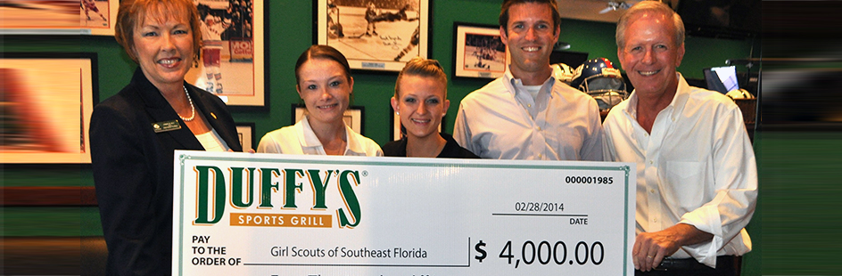 Duffy's Sports Grill charity check