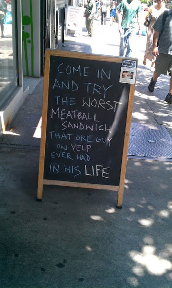 Humorous restaurant review sign