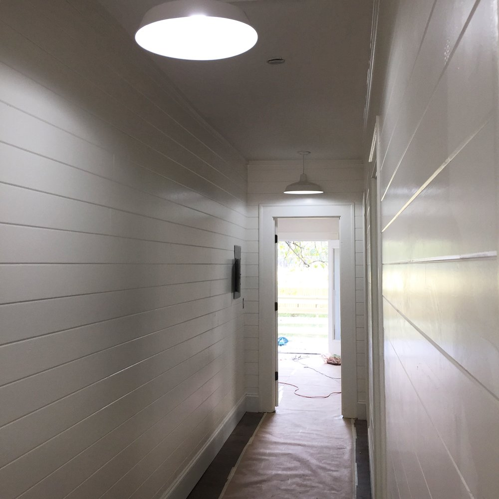 Shiplap entry/hallway leading to the master