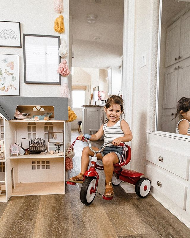 she rides her tricycle back and forth through our tiny house all day long 🙊 might need to invest in some steel toed shoes because no toes are safe in this house 😆