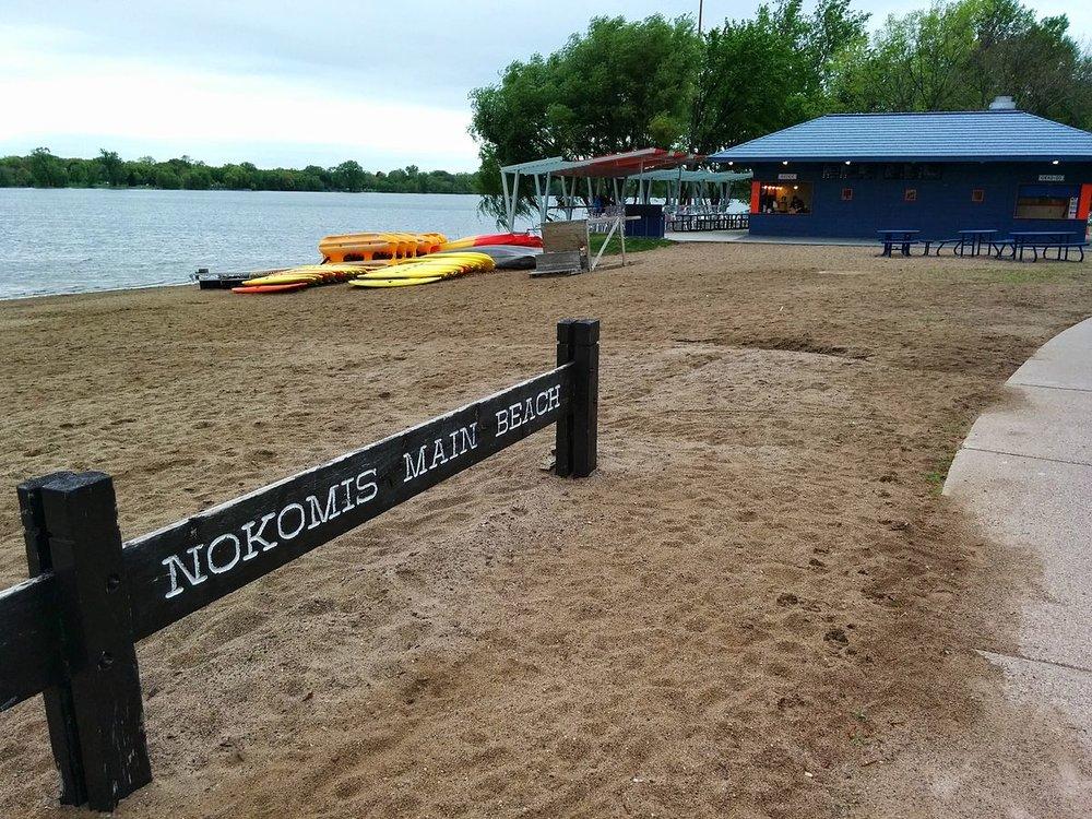 Copy of Lake_Nokomis_main_beach_sign,_boats,_and_Sandcastle_restaurant.jpg