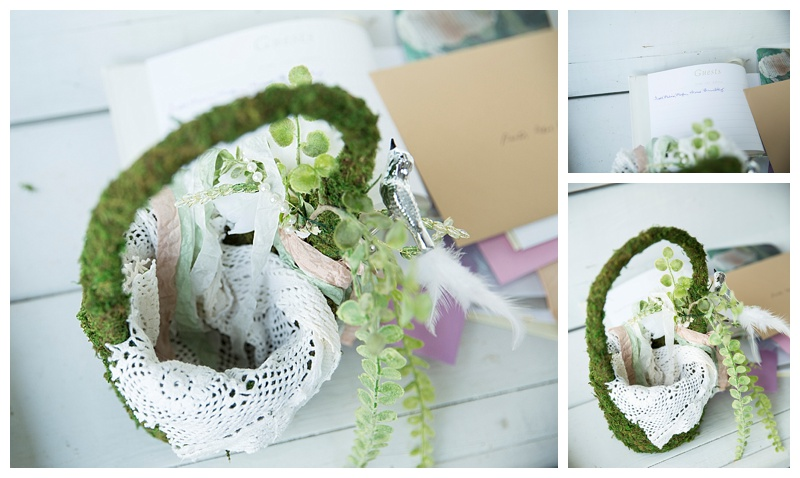 Moss covered flower girl baskets perfectly matched the theme of the wedding.