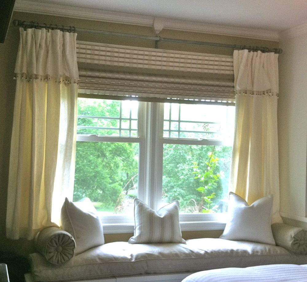 "Beachy Bedroom: Hunter Douglas ""Adelaide"" Bamboo Shade, Linen Curtains with D'Kei Sea Shell Trim, Linen Window Seat Cushion and Pillows"