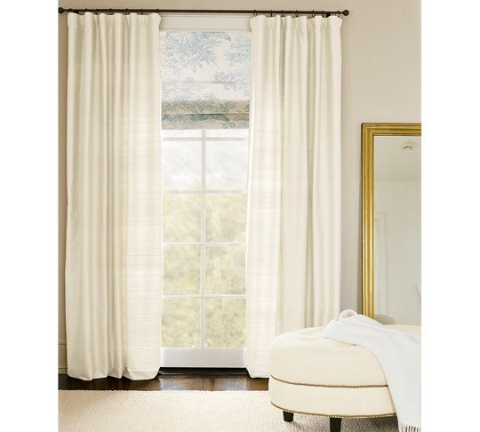 White curtains, installed too low, too short