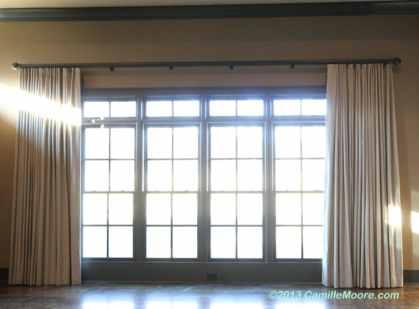 Linen Draperies, 3/8″ off of floor. Installed on Beautiful Operational Wood Traverse Track. Design: Camille Moore, Workroom: Camille Moore Window Treatments