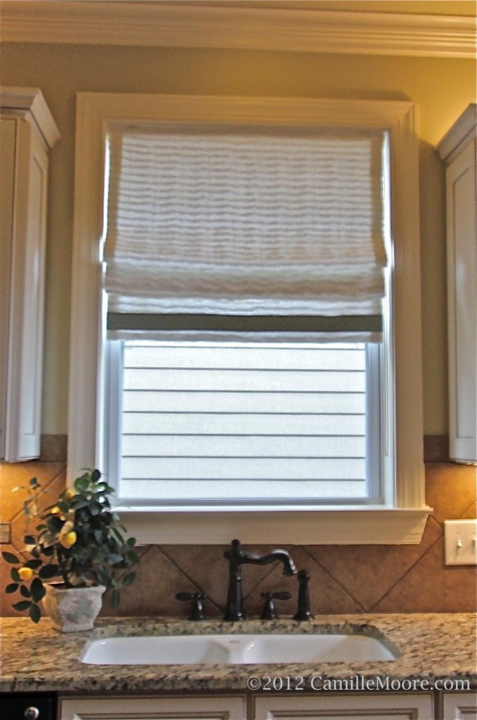 Flat Roman Shade made with tucked linen, banding trim along bottom edge