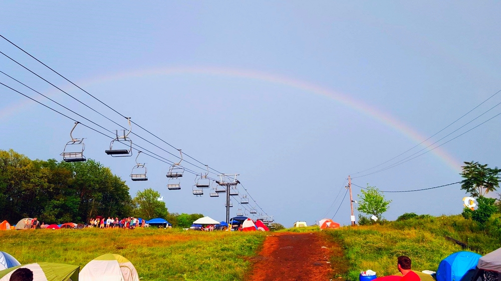 A double rainbow was gifted to the festival after the rainstorm on Saturday moved out as an good omen of things to come.