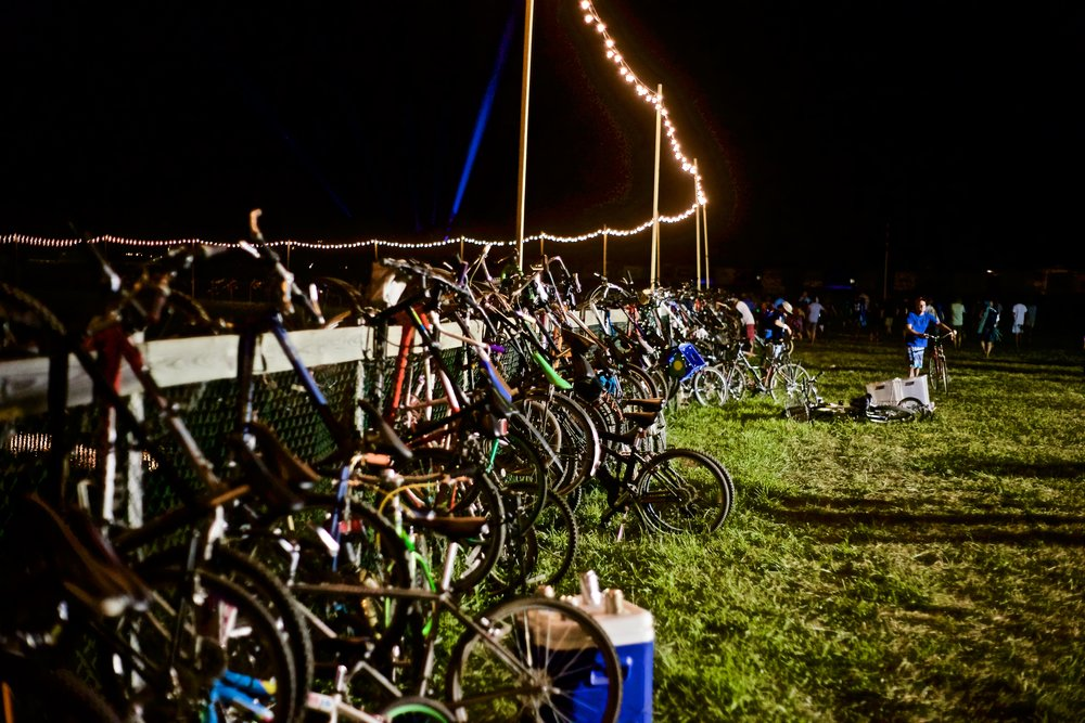 Hundreds of bikes lined the fence to a small pond right outside of the main festival grounds.