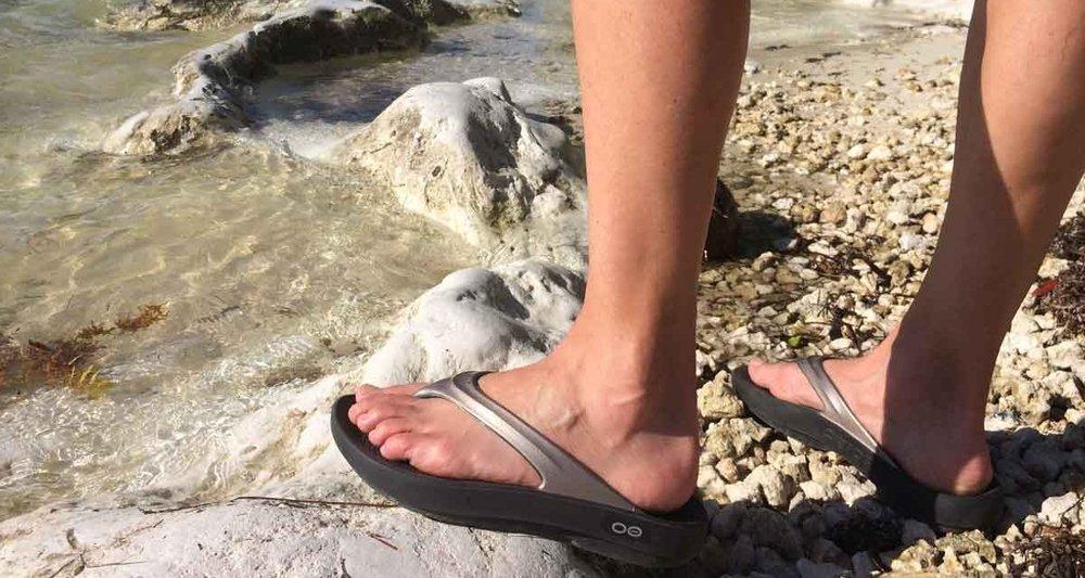 oofos-sandals-review-beach-1200x640.jpg