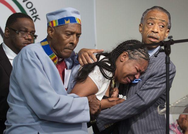Esaw Garner, wife of Eric Garner, breaks down.