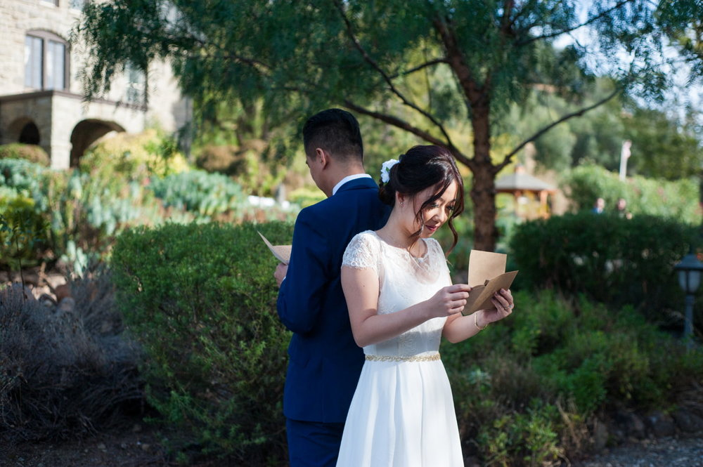 Bride and Groom reading letters to each other during first look