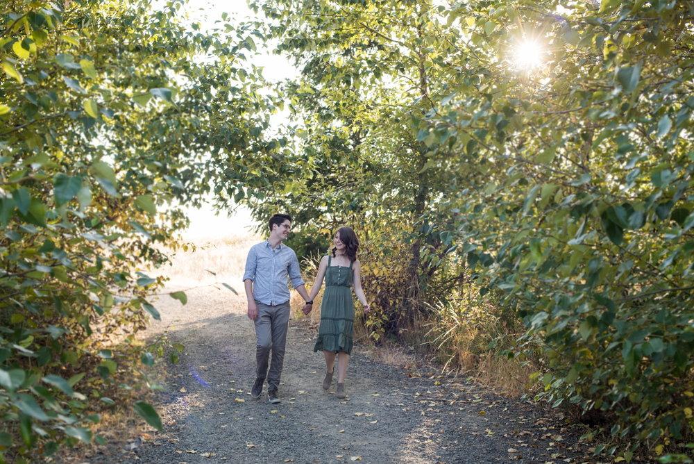 Happy couple walking through Powell Butte Nature Park
