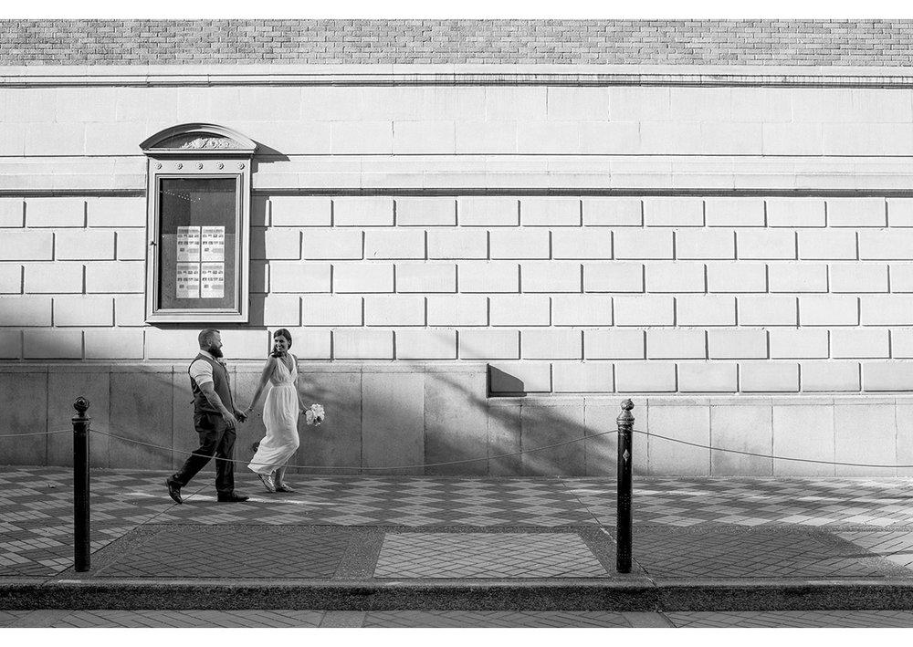 Bride and Groom walking in downtown Portland