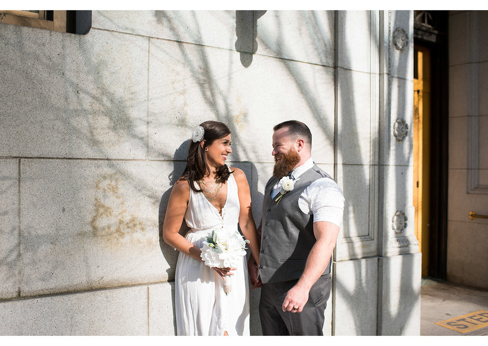 Bride and Groom outside of Multnomah County Courthouse in Portland