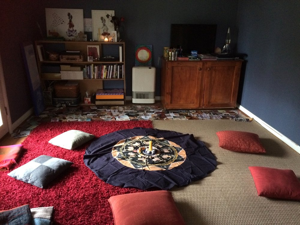 Setting the space, photograph of room with rugs on the floor, a round piece of material with candles in the centre, pillow surrounding the, pieces of cut out magazine at the far end of the room.  © all images by   Natalya Garden-Thompson, 2016