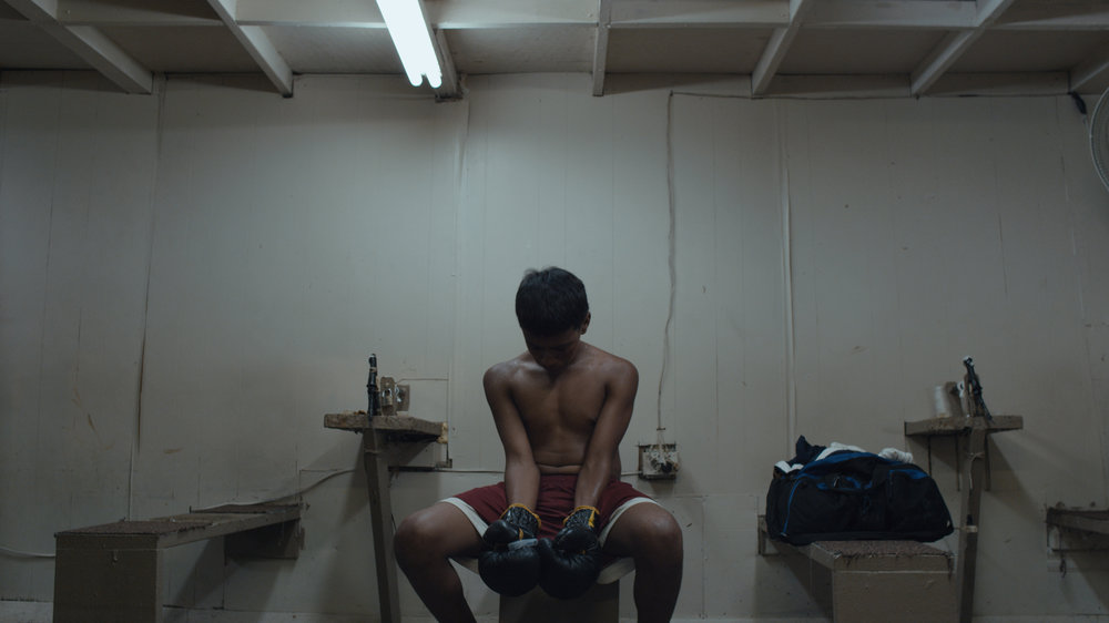 LA GRANJA A film by Angel Manuel Soto (Puerto Rico, 2015, 100 min. In Spanish with English subtitles) In the small sector of a Macondo-like island forgotten by the catastrophic effects of an economic depression and drug addiction, lives are pushed to the limit. A promising young boxer, a barren midwife, and a fat kid with a bike: three intersecting stories focus around the pursuit of happiness and its unanticipated consequences during the economic collapse of the island of Puerto Rico. Each actor in this modern day tragedy will ultimately discover how the pursuit of hope can dehumanize and expose underlying animal instincts. Winner of the Best First Film Award at the Guadalajara Film Festival and nominated for Best Foreign Language at the UK National Film Academy, La Granja held its world premiere at Fantastic Fest and had a successful film festival run playing at Tribeca, Raindance, Miami, among others. Soto's acclaimed debut feature offers a timely and electrifying portrayal of the hardships and hopelessness of life in modern Puerto Rico, and heralds the arrival of an exciting new voice in Puerto Rican cinema.