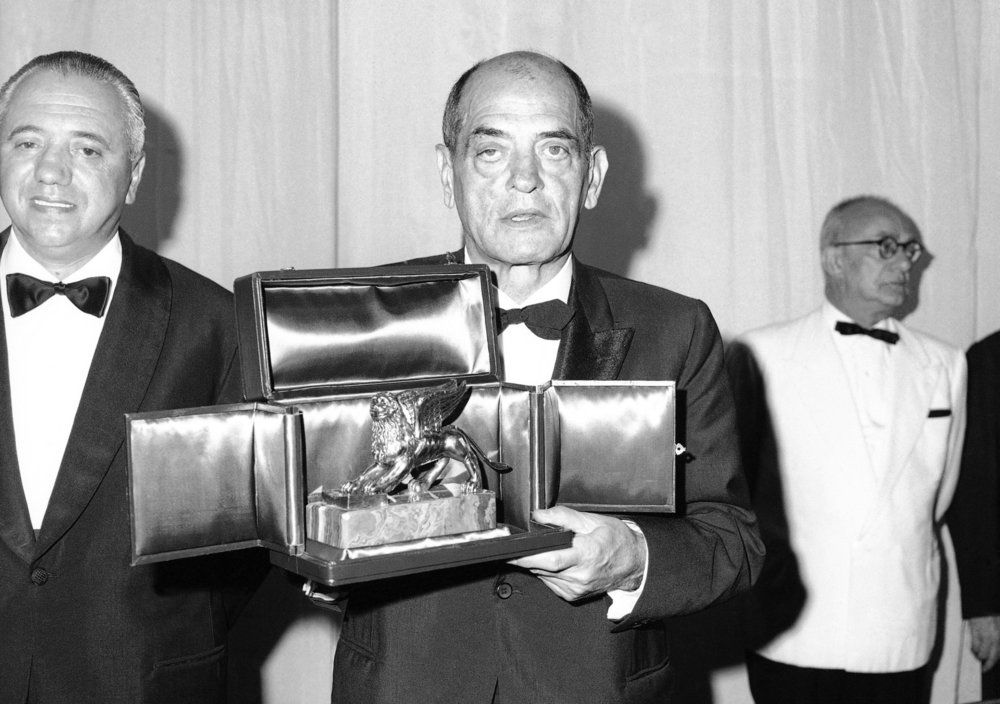 Mexican director Luis Buñuel receiving the Golden Lion.