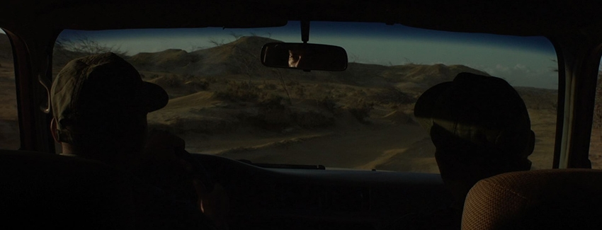 MARIANA  (Chris Gude, Colombia, 2017, 64 min. In Spanish with English subtitles. U.S. Premiere)  Q&A with Chris Gude   Buy Tickets   In this experimental road movie, director Chris Gude ( Mambo Cool ) follows two smugglers attempting to cross into Colombia from Venezuela. As the men drive across the sun-soaked terrain of the Guajira Peninsula, occasionally stopping off to wander or play pool in the lonely ruins of abandoned buildings, their journey comes to symbolize a search for an idealized land. Gesturing toward Colombia's colonial legacy (such as when the pair listen to a Hugo Chávez radio broadcast about Simón Bolívar), this beautifully photographed film gives the viewer ample room to ponder questions of space and identity.  Screening with  THE MOUTH  ( La bouche , Camilo Restrepo, France, 2017, 19 min. In Susu with English subtitles. U.S. Premiere) Following his 2016 film  Cilaos , Colombian director Camilo Restrepo again experiments with the musical genre in a film that uses radical aesthetics as a means of standing up to social injustice.   Saturday, March 3, 3:30pm